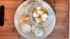 Kefir Cheese Balls with Garlic Salt Served on Crackers with Alfalfa Sprouts
